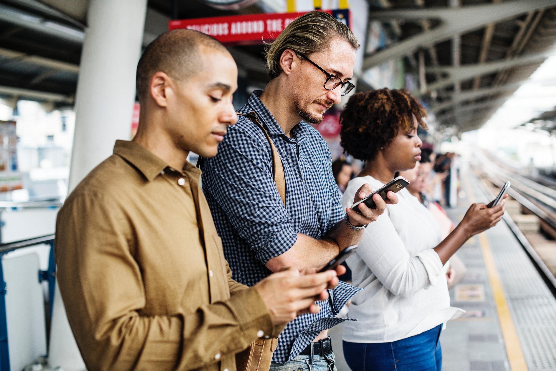 people on cellphones - Facebook ads for realtors
